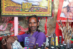 CANDOLIM, GOA, INDIA, 22 NOV 2014: Seller of souvenirs at the market in Arambol, Goa, India. Royalty Free Stock Photography