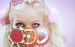 Candy. Portrait of young nice woman with lollypop on color  back Royalty Free Stock Photos