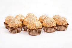 Candy. Candies in golden foil isolated on white Stock Photo