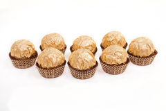 Candy. Candies in golden foil isolated on white Royalty Free Stock Images