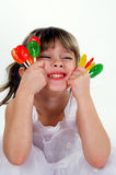 Candy. A young girl holding a handful of suckers royalty free stock images