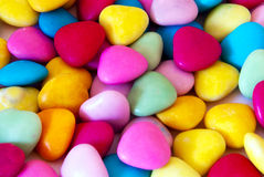 Candy. Many colourful candy filling background, or little hearts Stock Photos