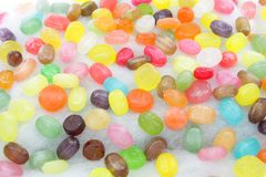 Candy. Different types of candy on a background of sweet cotton stock photography