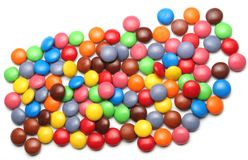Candy. Scattered colourful candy on a white background royalty free stock images