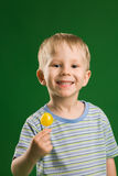 Candy. A photo of happy boy with lollipop royalty free stock photos