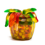 Candy. Gummy worms and candy corn in a glass jar Stock Photo