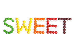 Candy. Colorful candies spelling the word seweet Royalty Free Stock Image