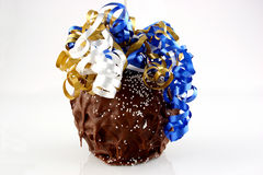 Candy Apple. A huge candy apple with sprinkles and multicolored ribbons Royalty Free Stock Images