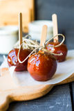 Candy apple, Christmas dessert. On a blue background stock photo