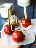 Candy apple, Christmas dessert. On a blue background Royalty Free Stock Photo