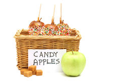 Candy apples in a basket for sale. Isolated on white Stock Photography