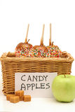 Candy apples in a basket for sale vertical Stock Photos