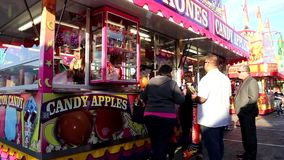 Candy apples booth at Coast Amusements Carnival stock footage