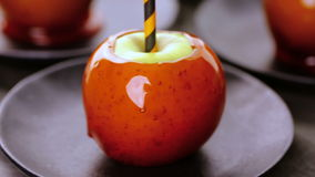 Candy apples. Handmade orange candy apples for Halloween stock footage