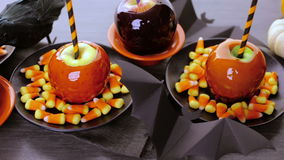 Candy apples. Handmade orange candy apples for Halloween stock video footage