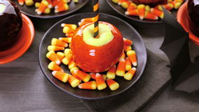 Candy apples. Handmade orange candy apples for Halloween stock video
