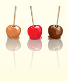 Candy apples reflected. Candy apples. Chocolate, caramel and toffee candy apples with reflection Stock Images