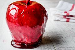 Candy Apples on white wooden surface. Ready to Eat Stock Photo