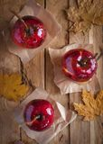 Candy apples on wooden background, top view royalty free stock photography