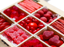 Candy assortment in a box. Nine candy varieties inside a wooden box Royalty Free Stock Image
