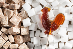 Candy on background of brown and white sugar Royalty Free Stock Photo
