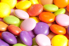 Candy background. Close up of sugar coated candy with shallow depth of field Royalty Free Stock Images