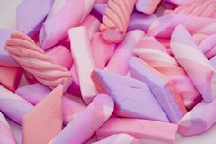 Candy background. Delicious candy background with pink and violet Royalty Free Stock Photo