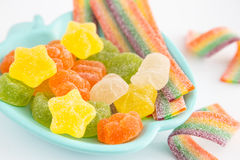 Candy background. Colorful candies in plate on light background Royalty Free Stock Photography