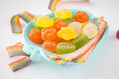 Candy background. Colorful candies in plate on light background Stock Image