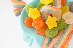Candy background. Colorful candies in plate on light background Royalty Free Stock Image