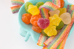 Candy background. Colorful candies in plate on light background Stock Images