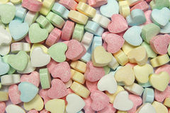 Candy background, heart-shaped sweets Stock Photos