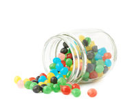 Candy ball sweets falling out of a jar Stock Photography