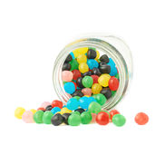 Candy ball sweets falling out of a jar Royalty Free Stock Image