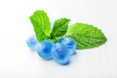 Candy balsamic syrup. Blue candy fresh balsamic syrup with mint leaves on a white background stock image