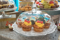 Candy bar with cake, macaroons and cake pops. Stock Photos
