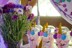 Candy bar on a child`s birthday. Decor with unicorns on the girl. `s holiday royalty free stock photos