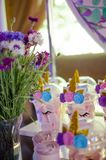 Candy bar on a child`s birthday. Decor with unicorns on the girl. `s holiday royalty free stock photography