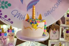 Candy bar on a child`s birthday. Decor with unicorns on the girl. `s holiday. Cake in the form of a unicorn royalty free stock photo