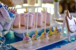 Candy bar on a child`s birthday. Decor with unicorns on the girl. `s holiday stock photo
