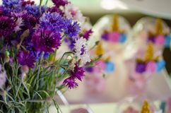 Candy bar on a child`s birthday. Decor with unicorns on the girl. `s holiday. Flowers on the front stock image