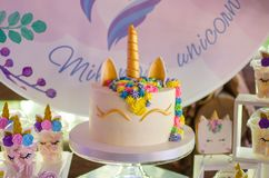 Candy bar on a child`s birthday. Decor with unicorns on the girl. `s holiday. Cake in the form of a unicorn stock photos