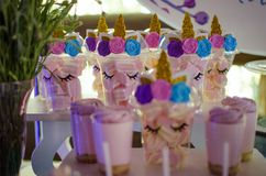 Candy bar on a child`s birthday. Decor with unicorns on the girl. `s holiday royalty free stock photo