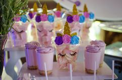 Candy bar on a child`s birthday. Decor with unicorns on the girl royalty free stock image
