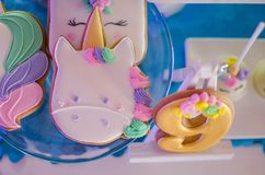 Candy bar on a child`s birthday. Decor with unicorns on the girl. `s holiday. Gingerbread in the form of number nine royalty free stock photos