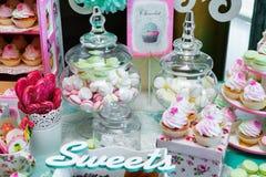 Candy bar. Colored cupcakes.   Stock Photos