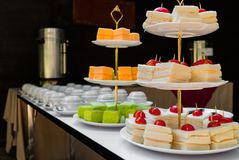 Candy bar, contains sandwiches, cakes, and coffee break in front of the conference room royalty free stock photos