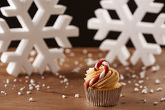 Candy bar cupcake on Christmas background Stock Image