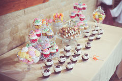 Candy bar. With cupcakes and fruits Stock Images