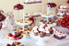 Candy bar. Cupcakes, macaroons and mini cakes in a candy bar Stock Photo